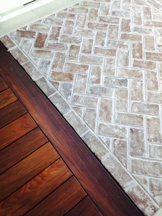 whitewashed herringbone brick floor. I love the contrast of brick and wood.