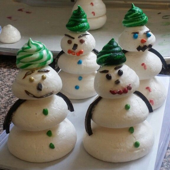 A delicious meringue snowman parade heading your direction this festive season for a fun unique treat for christmas delight your taste buds