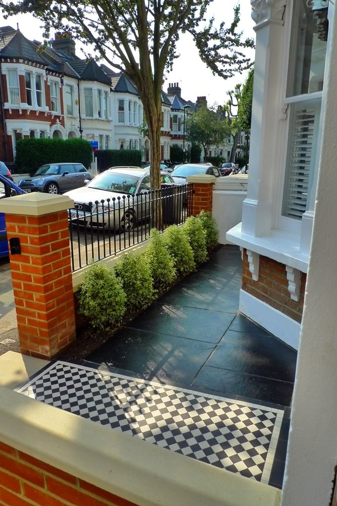 Brick wall + railings with white wall + slate floor - front garden idea