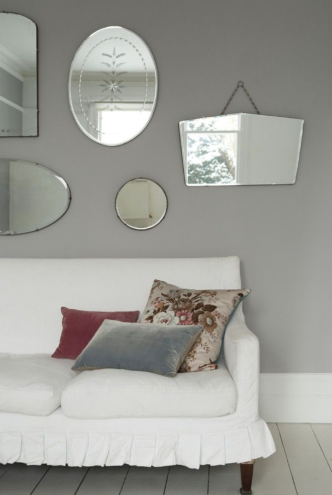 Dulux Potters Clay 2.  I like the display of mirrors. {nice colour for bedroom}
