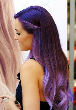 Long dark midnight blue wavy hair with a side part, a twisted pinned back side with purple dip dyed ends hairstyle