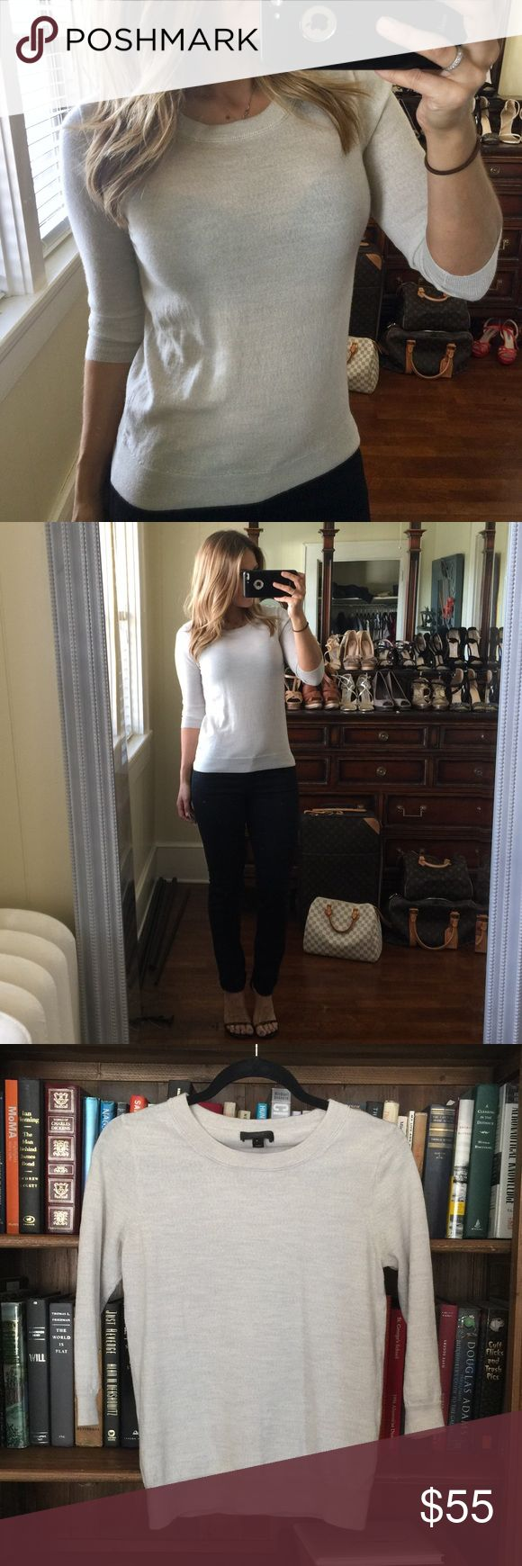 J. Crew merino wool sweater oatmeal S 3/4 sleeve J. Crew 100% Merino wool sweater.  No thick and bulky yet still warm.  Size Small.  Slim feminine fit.  Excellent condition.  It's not sheer but I accidentally modeled with a black bra and would just recommend a lighter colored one.  :). J. Crew Sweaters Crew & Scoop Necks