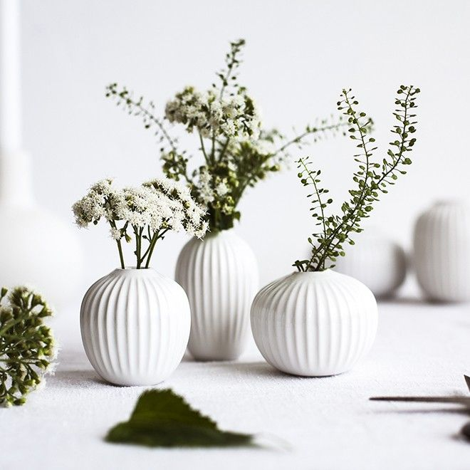 Experience the elegant Hammershøi vases in a 3-pack in classic white. Use the three, sweet miniature vases as decoration in a lovely tableau or on the table filled with little flowers and fresh twigs from the garden. The miniature vases feature the classic Hammershøi furrows inspired by the world-famous artist, Svend Hammershøi, who created his works at Kähler's old workshop in Næstved.
