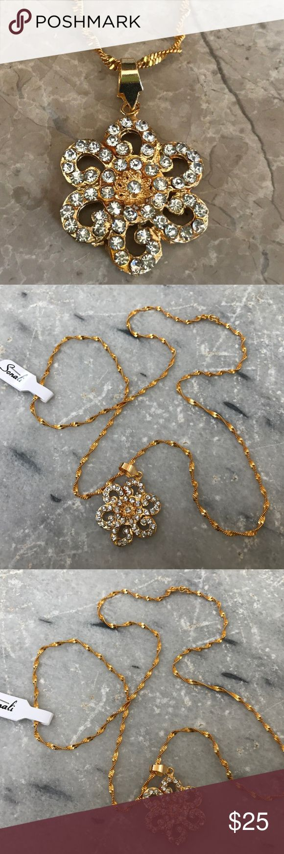 Women Necklace Gold Chain Pendant Neck Indian Mala Women's Necklace Gold Chain Pendant Neck Indian Mala Bollywood Ethnic Jewelry  Color: Gold ( See the Photos )  Size: 24 Inches long Chain  NOTE: This is an artificial Jewelry and not real gold.   Brand New, never Used Jewelry Necklaces