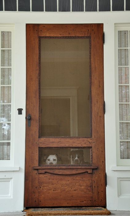This is the kind of screen door I need! Dogs can see out but not run through the screen.
