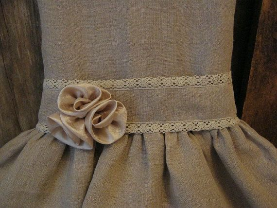 This girls dress is made of an unbleached,undyed 100% linen with a lace trimmed sash, would make a perfect flower girl ruffle dress in a