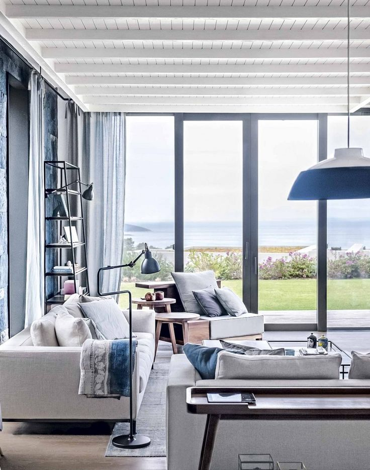 Create a contemporary coastal scheme in your living room with cool tones and angular shapes