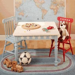 "Adorable Farmhouse Table and Chairs are just the right size for your little ones! The Farmhouse Table features a denim blue base and legs bordered by cute off-white stars! The sturdy child-size chairs are available in either denim blue or rusty red, accented with off-white stars too! The table has a 30.5"" square top and is 22"" H."
