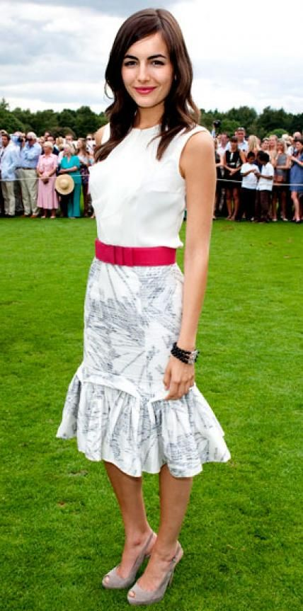 Look of the Day › July 26, 2010 WHAT SHE WORE Belle attended the Cartier Polo match in Windsor, England in a ladylike ruffled top paired with a print skirt and cerise belt, all from Carolina Herrera.