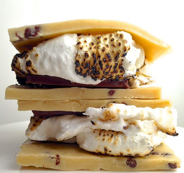 When graham crackers are feeling a little too basic, try sandwiching toasted marshmallows and chocolate with flattened pieces of cookie dough.