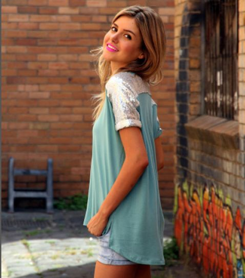 Introducing the Madison Square 'Not Your Girlfriend Tee'. Dress this gorgeous Sage coloured Tee up with some black pants and heels. Or for daytime wear looks stunning with a pair of shorts. Tee features a draping panel at the rear and sequin detailing over arms and shoulders.