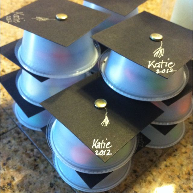 Graduation party favors! Condiment cups with a lid, craft paper, folding pin and M for the treat! Really easy and fun :)