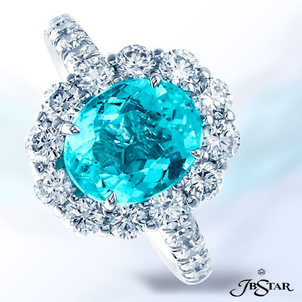 Style 2371 Gorgeous paraiba and diamond ring exquisitely designed with a 2.59 ct oval paraiba encircled by 12 round brilliant diamonds in platinum setting.