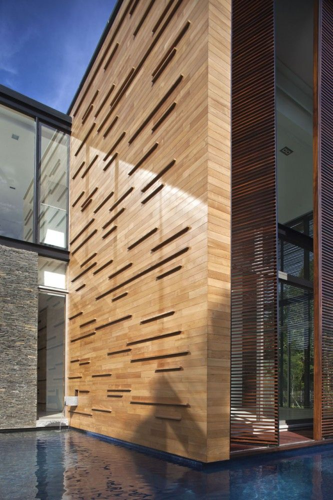 22 Oei Tiong Ham Park / AR43 Architects. I love the timber wall, the battons extruding out give in some depth.
