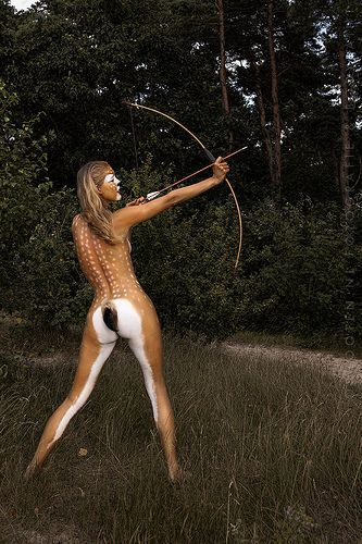this is body paint, but could be done with a nude body suit as a costume!