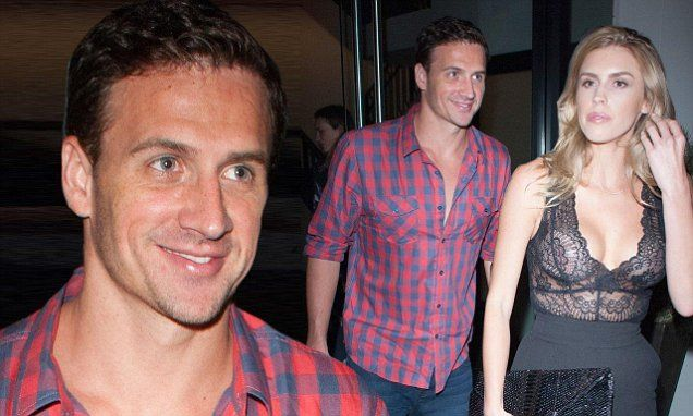 Ryan Lochte can't stop smiling while with playmate girlfriend