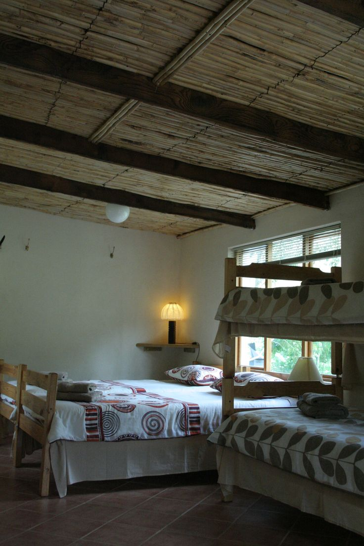 """Inside """"July se huis"""" showing the reed ceilings and 4 beds."""