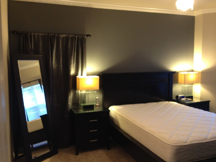 Accent wall in master bedroom valspar almost charcoal for Charcoal grey bedroom