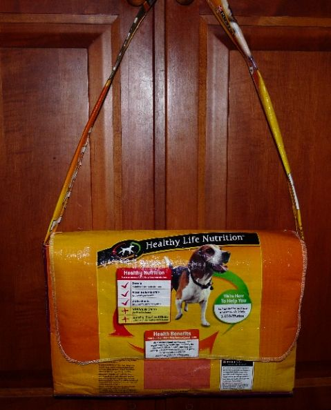"""dog food sack into messenger bag. I always use mine as an """"extra"""" trash bag, but this is a much better use in my opinion!"""