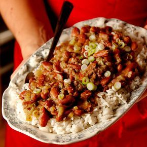 Red Beans and Rice Recipe Main Dishes with canola oil, garlic, celery, yellow onion, green bell pepper, kosher salt, ground white pepper, dried thyme, dried oregano, cayenne, ground black pepper, dried kidney beans, bay leaves, smoked ham hocks, hot sauce, cooked white rice, scallions