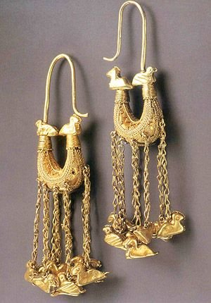 SCYTHIAN BOAT EARRINGS WITH PENDANTS Catalogue #129 4th c., Gold From Kurhan 8, burial z, near village of Volchans'ke, Akymivs'kyi Raion, ZaporizhSka Oblast'. UKRAINE This pair was found in the burial of a Scythian woman, along with a splendid gold necklace and a headdress richly decorated with gold plaques.