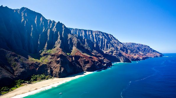 It's hard to describe the sheer majesty of Kauai's Napali Coast, with its sheer, razor-sharp ridges that seem to drop straight to the earth. By helicopter, you're privy to cascading waterfalls and hidden inlets, and depending on your pilot, you might even swoop down into a cave. If you thirst for the sea,  catamaran cruises and zodiac tours are the way to go. For experienced hikers, the multi-day hike along the rugged coast is among Hawaii's most scenic.
