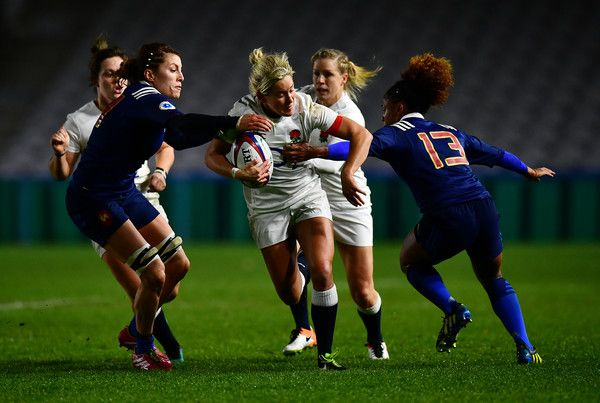 Claire Allan of England is tackled by Laetitia Grand and Rose Thomas of France during the Old Mutual Wealth Series match between England Women and France Women at Twickenham Stoop on November 9, 2016 in London, England.