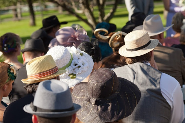 The couple asked their friends and family to come in hats and gave gloves to the ladies.
