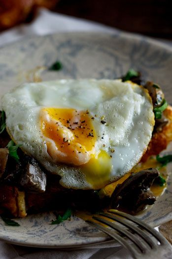 creamy sautéed mushrooms are between that yummy egg and sour dough bread toast!  you can't go wrong here!