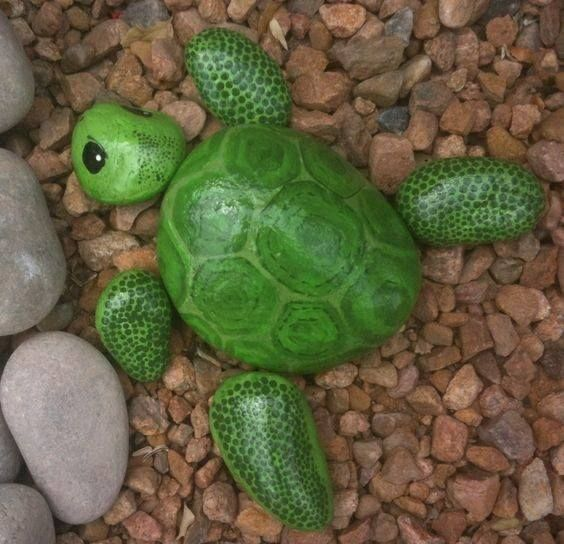 Turtle painted on river rocks.