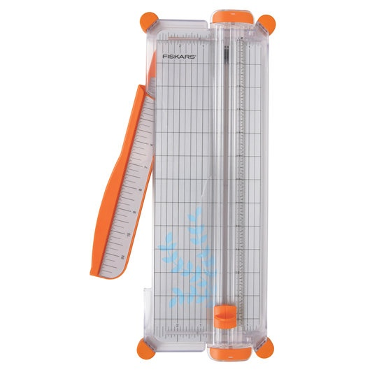 Paper cutter by Fiskars.  This is different from other trimmers, as this has a wire that indicates exactly where your cut will be.  Hard to explain, but once you use it, you'll be hooked.