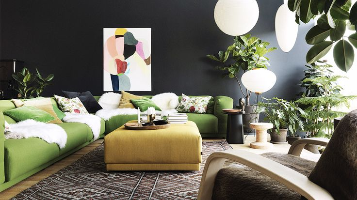 Sofas 101: The Ultimate Guide to Shopping for a Sofa // black walls, green sofa, lanterns: Fiction Couple, Green Couch, Living Rooms, Vitrahaus Loft, Throw Pillows, Dark Wall, Black Wall, Colour Schemes, Studios Il