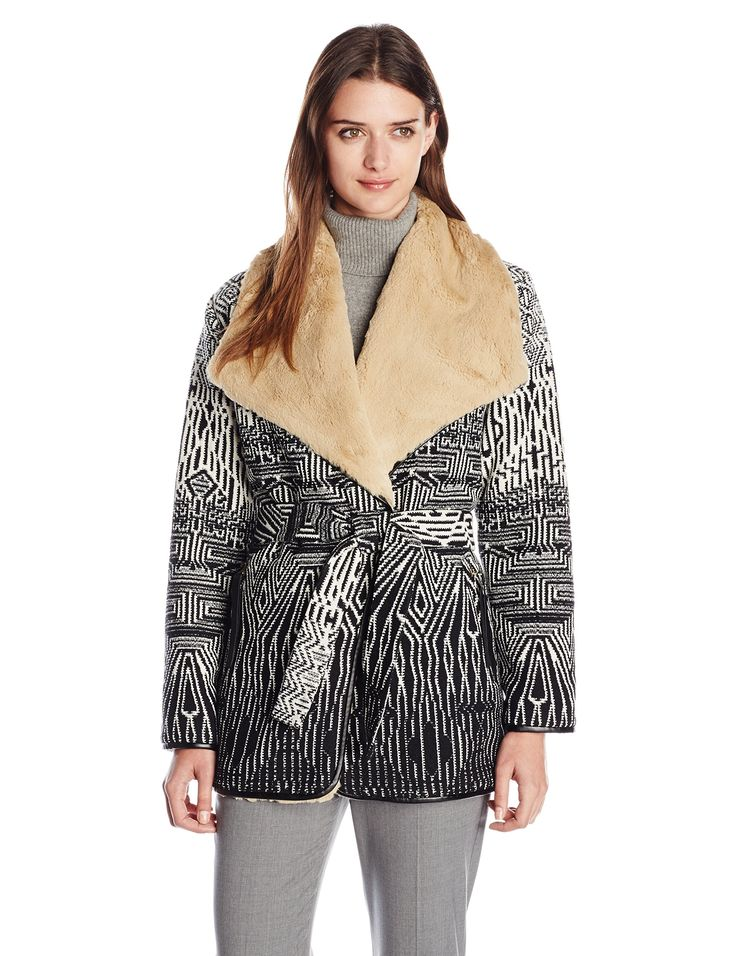 Twelfth Street by Cynthia Vincent Women's Chindo Blanket Wrap Coat, Black/White, Medium. Blanket wrap coat in geo pattern knit featuring oversize collar with fleece lining and faux-leather trim. Self belt.