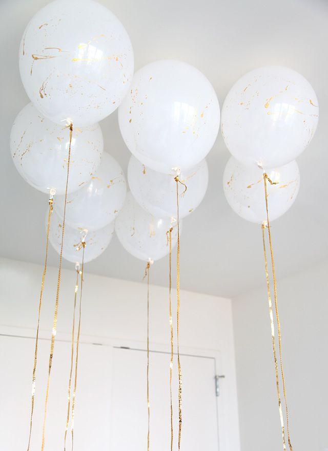 white + gold balloons