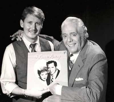 """Desi shows off the """"I Love Lucy"""" record that came out in the early 80s featuring music from the show."""