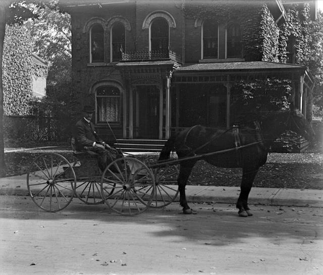 This image is of Jessie Bell Dixon's father, William Dixon, in front of their house at 61 East Avenue South, Hamilton.