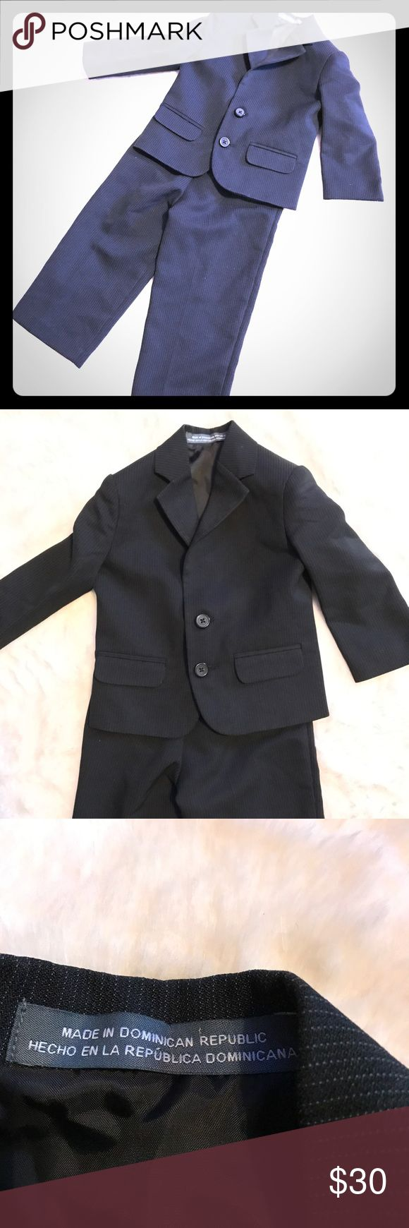 """Perry Ellis 2 pc 2T boy dress church wedding suit Black in color with the faintest of white pinstripe.  EUC no signs of wear but we did use/dry clean for a wedding. Size 2T elastic waist on pants 2 button closure.  Smoke free dog friendly  Pants: 19.5"""" length 8.5""""-11"""" stretched or even possibly more.  Coat: 16"""" length, 12"""" arm pit to pit, 7.5"""" sleeve length from pit to cuff.   Smoke free dog friendly home! Ask me about more 2T items to take advantage of the $6 shipping!! Perry Ellis Matching…"""