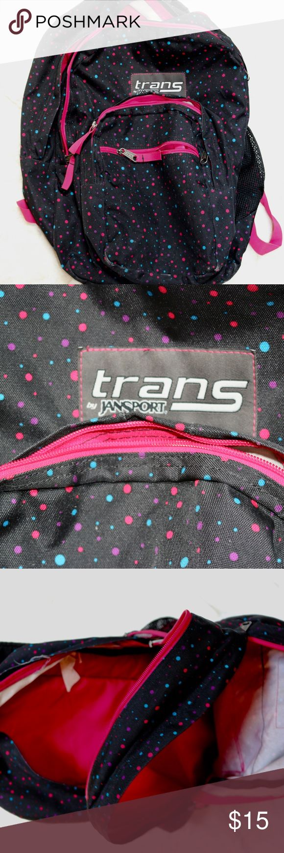 Trans Jansport Backpack, Black w/ Colored Pattern Black Trans Jansport backpack with pink, purple, and blue polka-dot pattern. Has two mesh water bottle holders, one on each side (one has slight damage, see image 4). Hot pink interior and adjustable straps. GREAT for back to school or for casual use! Pre-loved, but still in great condition! Jansport Bags Backpacks