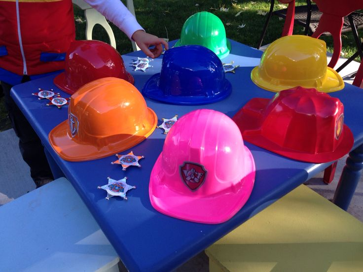 I ordered these hard hats (child sizes) from various online vendors and added homemade stickers. To make the stickers I saved pictures from interwebs, photoshopped and printed onto adhesive (sticker?) paper - standard 8.5x11 sheets. I then cut the stickers out by hand.