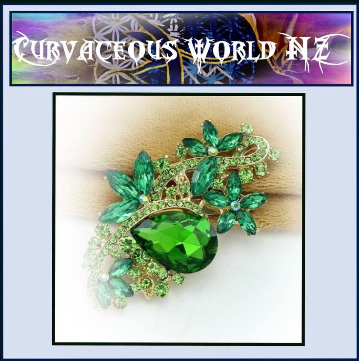 Rhinestone Flower Shamrock Green Silver or Gold Oval Broach for just $35.00.  ORDER HERE....... https://goo.gl/J9OhTI   Women's Large Flower Rhinestone Silver Broach comes in Blue (Gold), Cerise (Silver), Clear (Silver), Purple (silver) and Green (gold).   Measurements. Length 8cm by 4.5cm. #silver #DangleEarrings #eternity #BatWingSleeve #SizeT #HeartRings #SizeS #FashionRing #LondonBridge #PinkTopaz #TearDropEarrings #affordable #ChiffonCoralBlouse #SilverPendant #RhinestoneBracelet