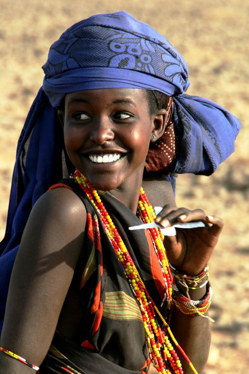 Happy African lady...note: no fluoride added to water in Africa - and hardly any dentists anywhere - so why do they have the best teeth anywhere?!