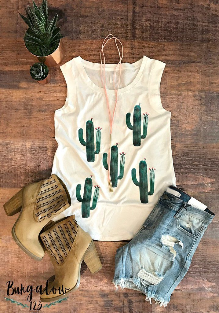 Ultra-soft tank in white featuring gorgeous watercolor cacti on the front. Straight fit. Shown with the Hutto Shorts and Avaly Booties. 100% Cotton.