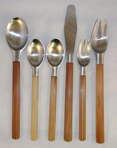 'Toke' Flatware By Quistgaard Denmark 1960's Hand forged Danish stainless steel flatware with handles of thick bamboo. Made in Denmark by DANSK.