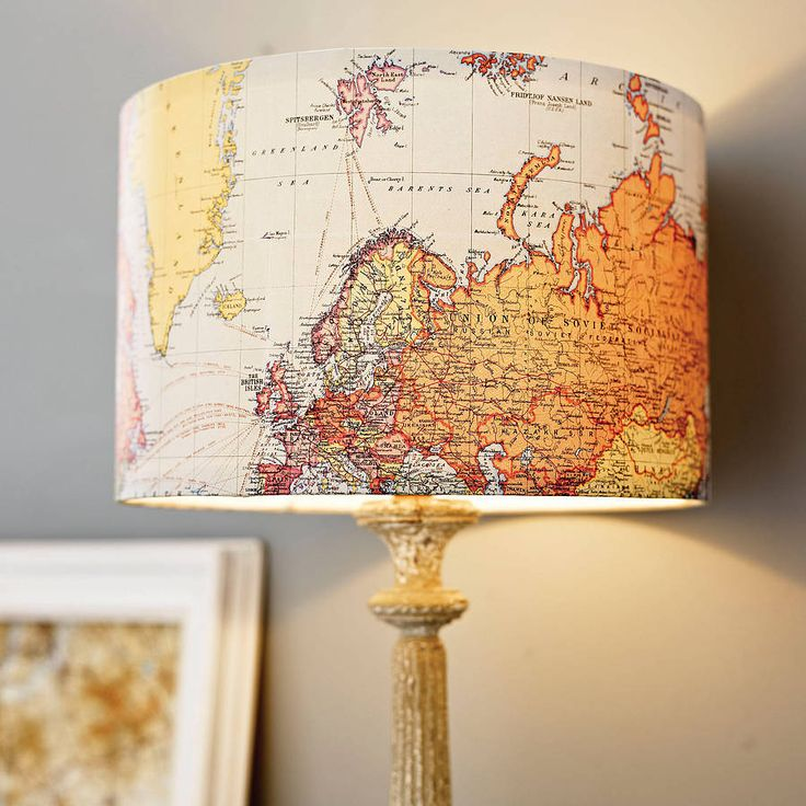 Modge podge a map onto a lamp shade. For a library/study room.