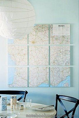 I would like to do this with a black and white vintage-y map of Paris or New York, hang it over the bed and pair with a black chandelier. But I have no clue how to mount the map on those little bricks.