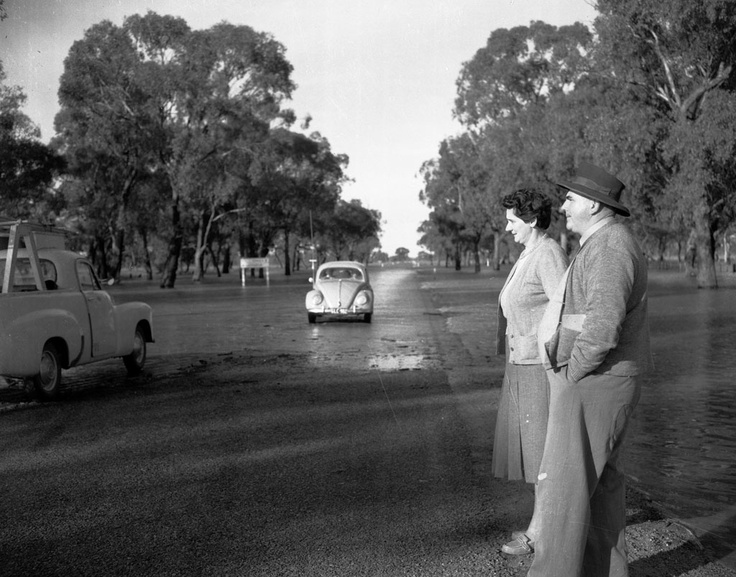 1956 Murray Valley Highway car on flooded section near Nathalia. VicRoads Centenary 1913 - 2013. www.vicroads.vic.gov.au/centenary