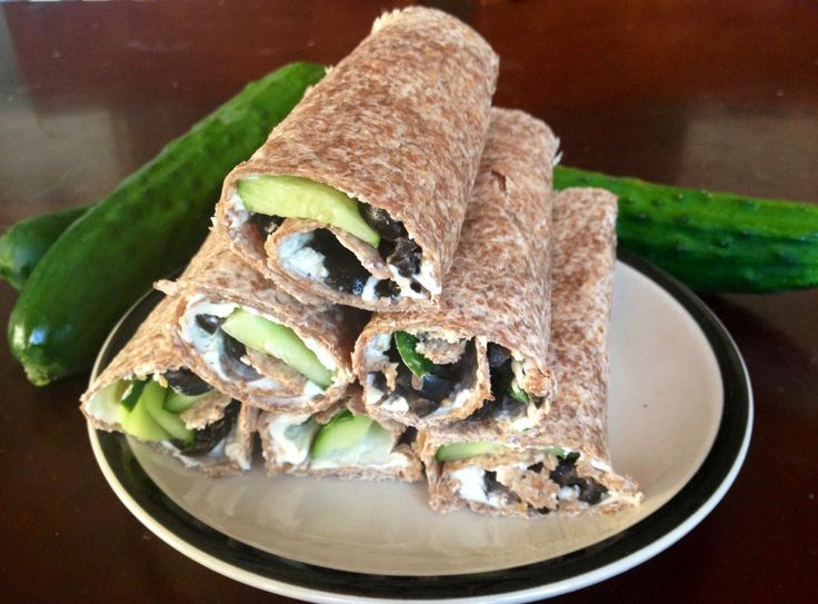 HEALTHY Cucumber cream cheese roll ups! Refreshing, and satisfying for summer! Kid APPROVED!!    6 Ezekiel sprouted wraps   2-3 thinly sliced cucumbers   1package cream cheese   1large can sliced olives   Onion powder    Spread cheese onto wrap and sprinkle with onion powder. Add olives and cucumbers. Roll up and voila!