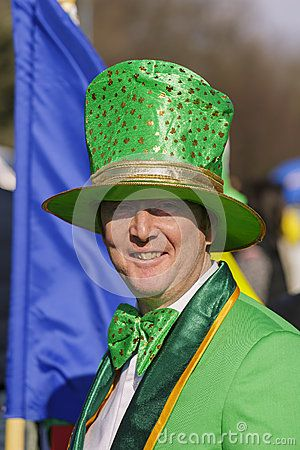 St. Patrick's Day Parade. Unidentified man wearing traditional Irish green hat and costume shares a smile during the 2nd St. Patrick's Day Parade on March 16, 2014 in Bucharest, Romania. Photo taken on: March 16th, 2014  Download this Editorial Photo of St. Patrick's Day In Bucharest, Romania. for as low as 0.68 lei. New users enjoy 60% OFF. 22,147,250 high-resolution stock photos and vector illustrations. Image: 38899421