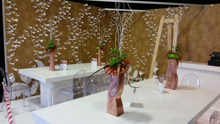 @Decorex2014 Chocolate Bar flower arrangements in Copper vases