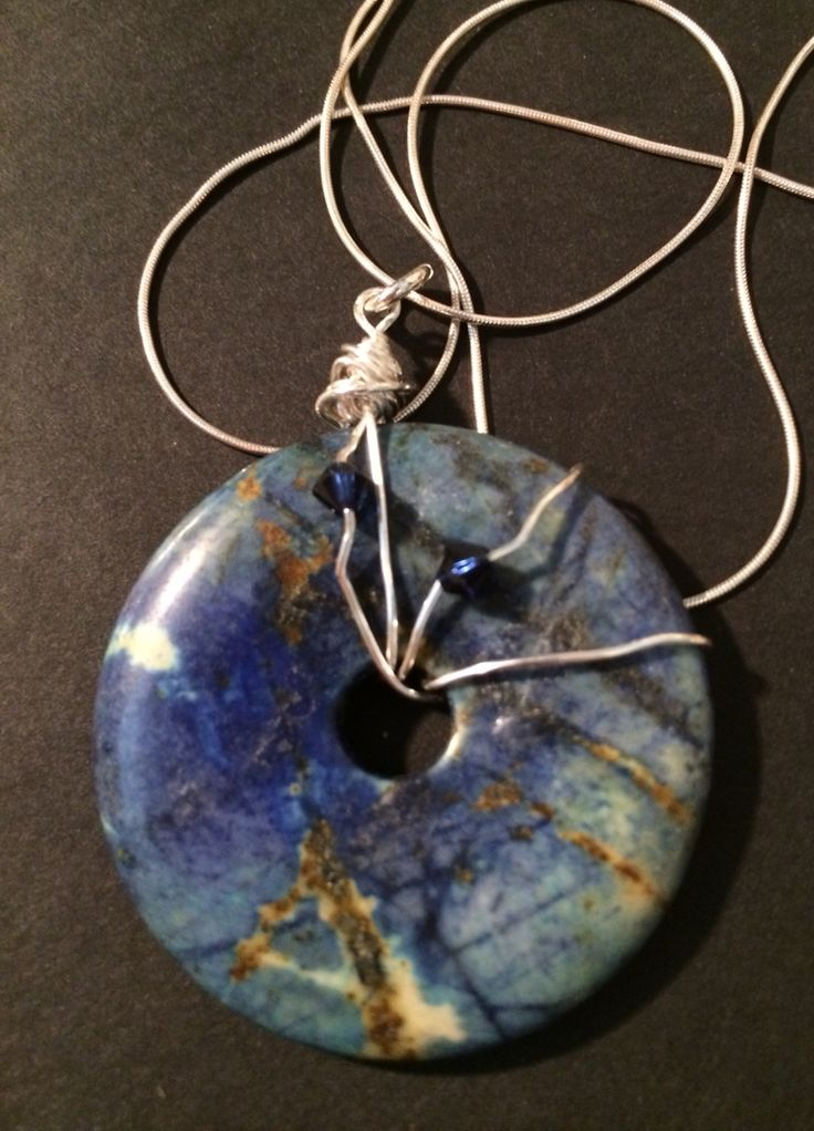 Lapis lazuli pendant wire wrapped and accented with Swarovski crystals